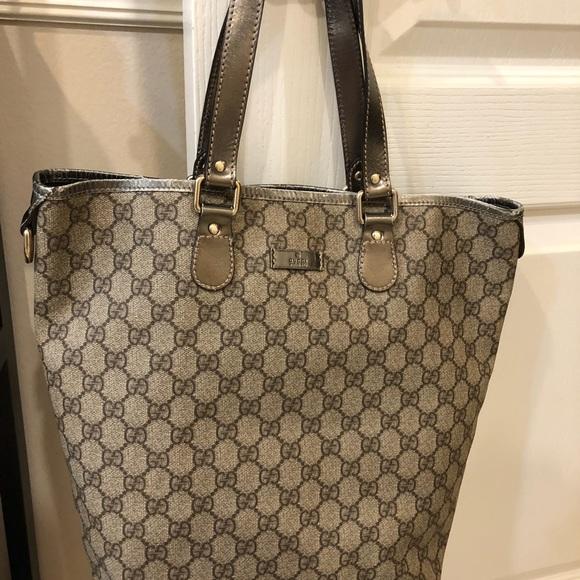 77fbea478b7a Authentic Gucci Logo Canvas Leather Tote. Gucci.  M_5ba6ed5c035cf18bcfe9f3e7. M_5ba6ed6045c8b3372933dacc.  M_5ba6ed649519963bb4eebed1